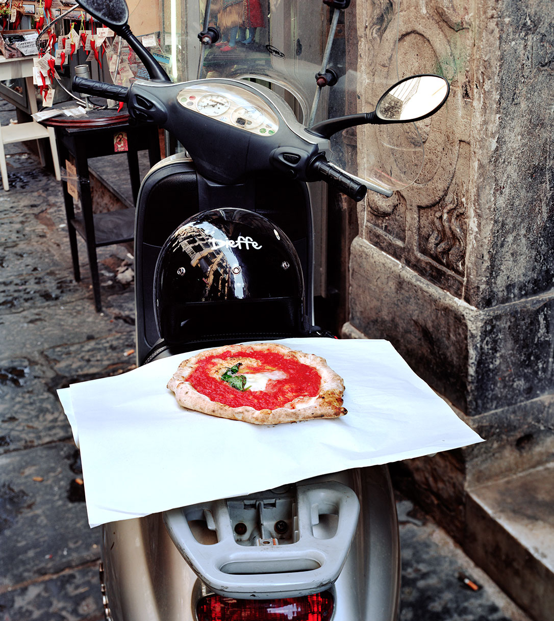 pizza on a scooter